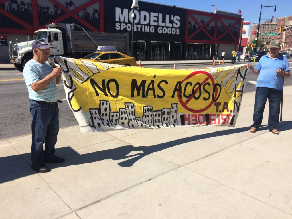 Brooklyn Residents Hold banner Reading 'No Mas Acoso' or No More Harassment as part of Renters Day Of Action.